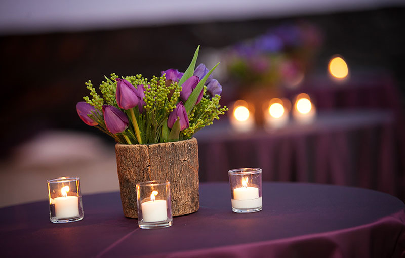 Cocktail Table with Flower Arrangement and Candles